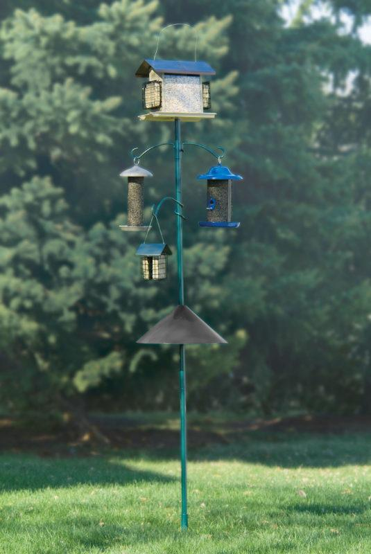 Squirrel-X™ by More Birds® 18 inch Wrap-Around Squirrel Baffle installed on bird feeder pole