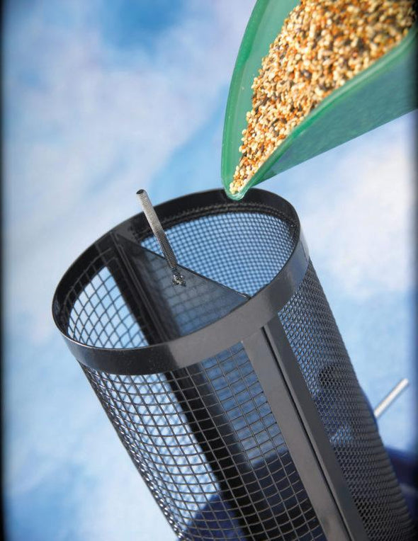filling More Birds Cobalt Twin Dual-Compartment Screen Feeder with birdseed