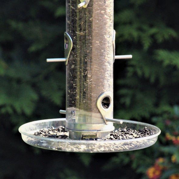 close-up of Droll Yankees Omni Seed Tray attached to bird feeder