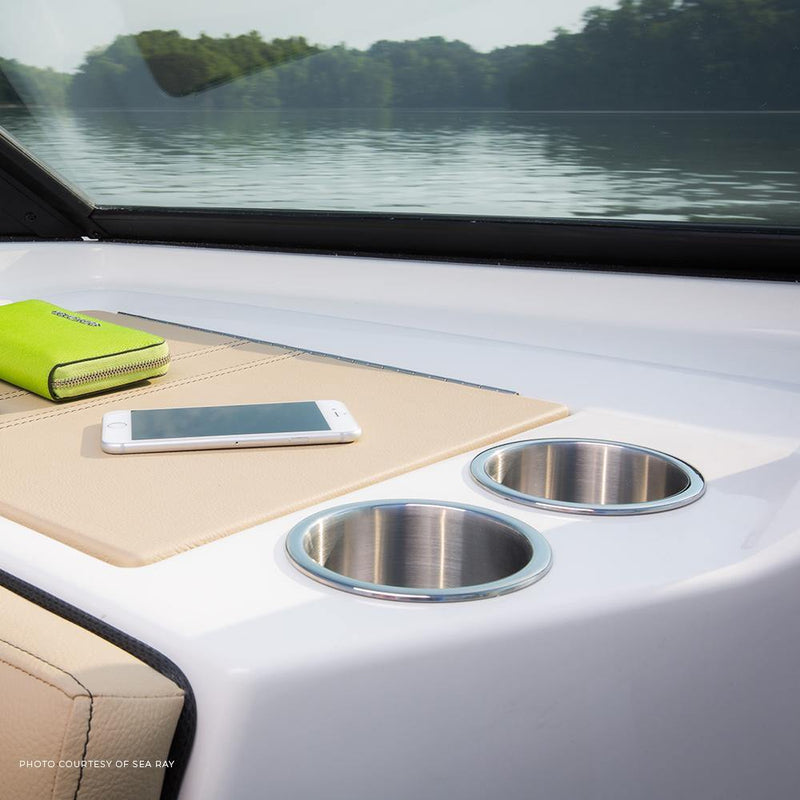 Stainless steel cup holders with a flat bottom installed in a boat.