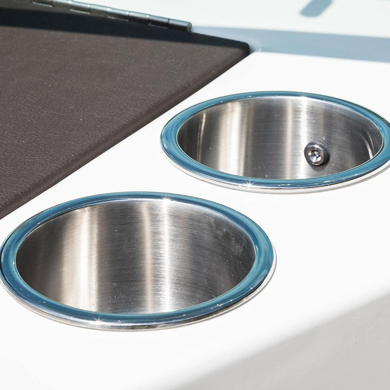 Stainless steel cup holders with a flat padded bottom, two drain holes, and inner white LED light installed on a boat.