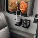 Two adjustable drink holders installed in a RV.  One is holding a bottle of wine and the other is holding a stemless wine glass.