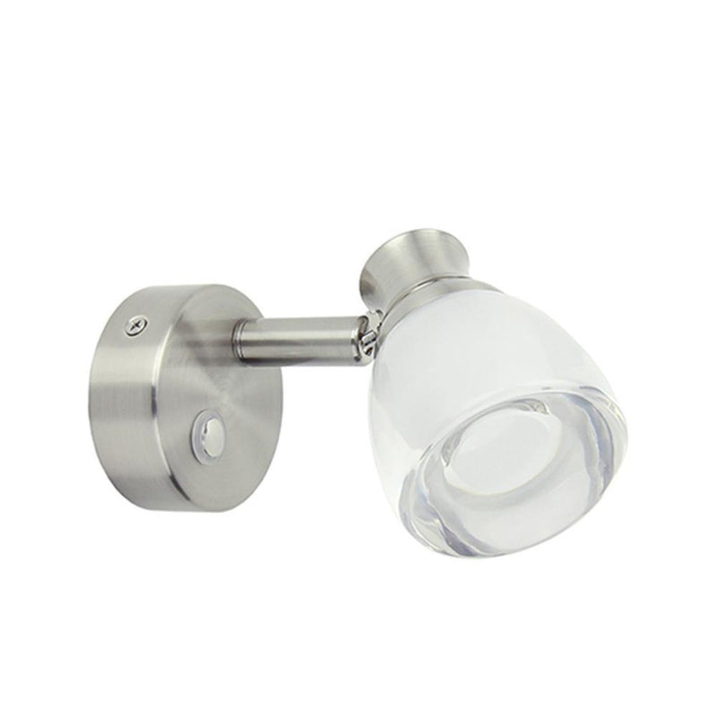 Wall mount reading light with a brushed nickel finish and a formed acrylic lens.