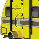 Black assist handle with black foam padding in the center. Handle has hinges on the top and bottom and is installed by the outside door of a yellow RV.