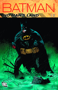 Batman stands bleeding in a noxious green puddle of rubble.