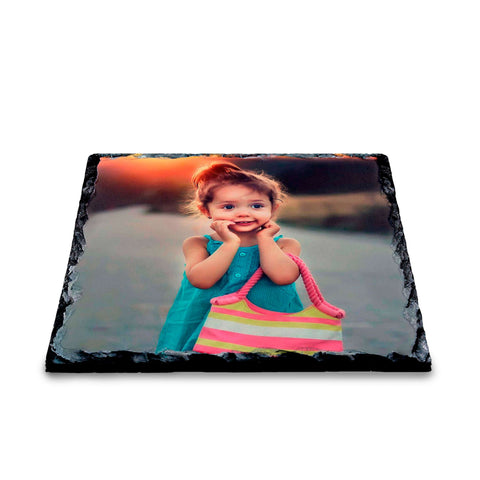 Photo slate coaster on white background featuring a little girl holding a bag