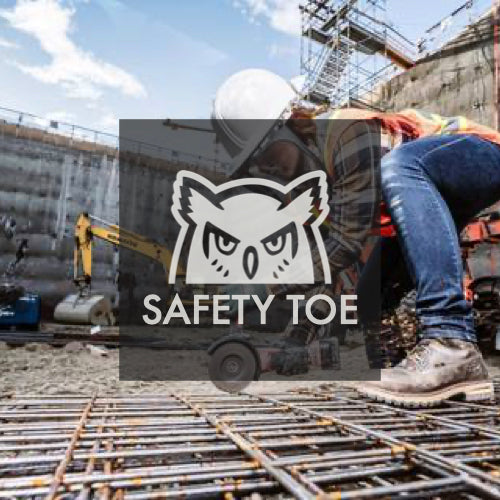 Woman working on construction site. Cutting rebar, wearing hard hat and safety toe work boots