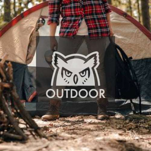 Woman camping. Standing in front of a tent with backpack and boots.