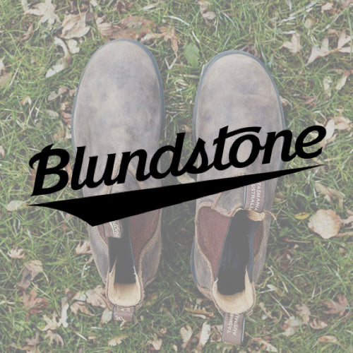 Blundstone logo over a photo of women's work boots in the grass