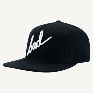 Front  view of BAD Snapback Hat with script lettering.