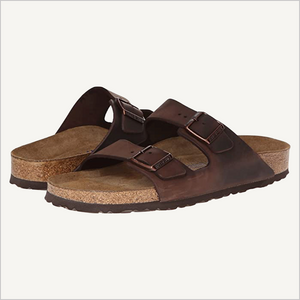 Side view of a pair of Birkenstock Arizona Oiled Leather Soft Footbed Sandals in Habana.