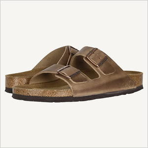 Side angle view of Women's Birkenstock Arizona Oiled Leather Soft Footbed Sandal in Tobacco.