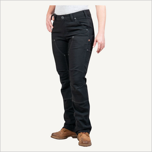 Front angled view of woman wearing Dovetail Brit Utility pants in No Fade Black Canvas.