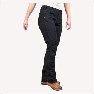 Side angled view of woman wearing Dovetail Brit Utility pants  in No Fade Black Canvas.