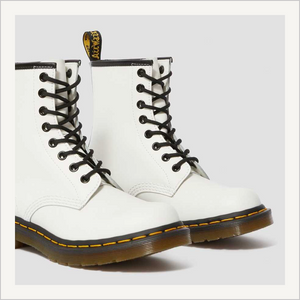 Side angled view of a pair of Dr. Martens 8 Eye 1460 Slip Resistant Lace Boots in White.