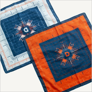 Top view of two of Dovetail's Women's Baseline Bandanas in Grey and blue and paprika and blue.