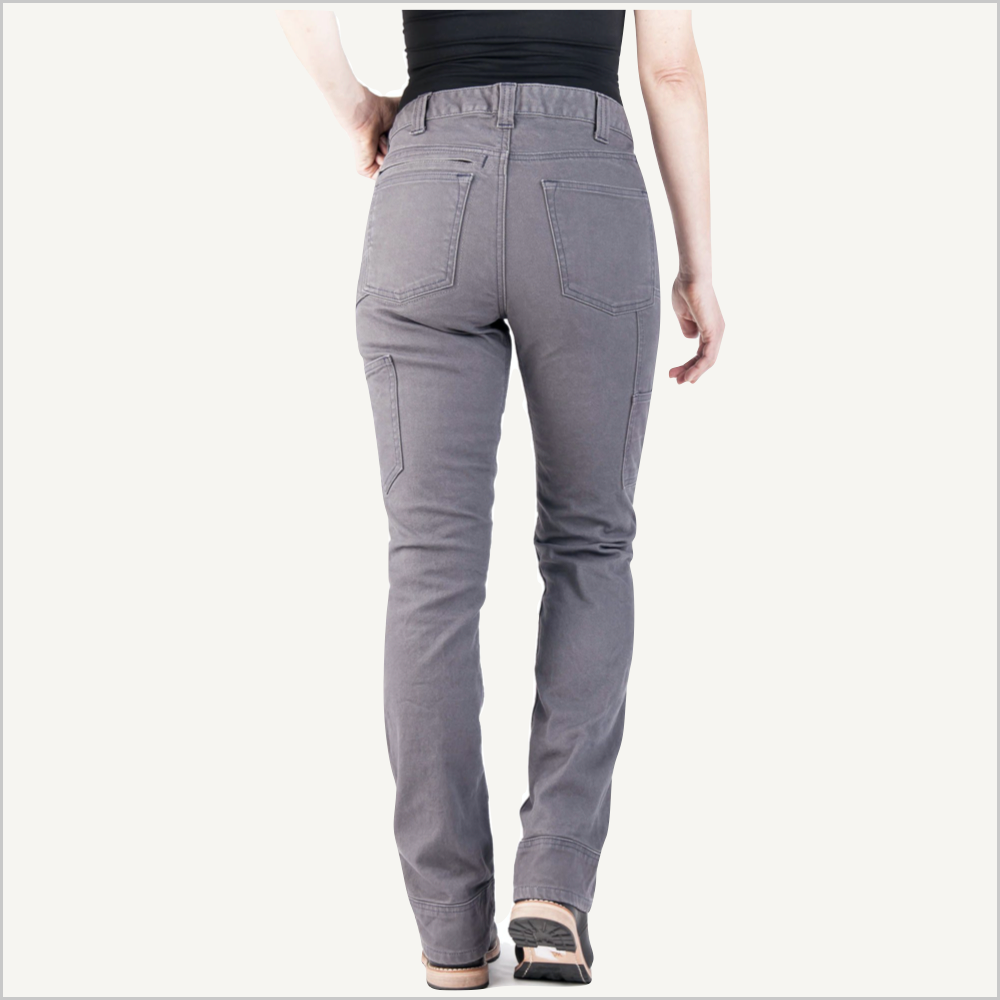 Woman wearing Dovetail Women's Britt Utility Pant in Grey Stretch Canvas. Her backside is facing the camera and only her waist down is visible.