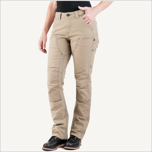 Front view of woman wearing Dovetail Women's Britt Utility Pant in Natural Stretch Canvas. She is wearing a black shirt and work boots and is only visible from the waist down.