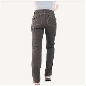 Backside view of woman wearing Dovetail Day Construct Stretch Canvas Work Pant in Dark Brown. She is wearing a grey shirt and camel work boots and is visible from the waist down.