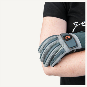 Close up of woman wearing Dovetail Impact Protective Work Glove. Her arms are crossed and her gloved hand is resting on her elbow. Only the glove and her arm is visible.