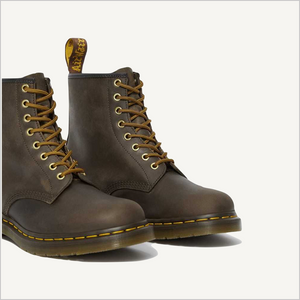 Side angled view of a pair of Dr. Martens 8 Eye 1460 Slip Resistant Lace Boots in Aztec.