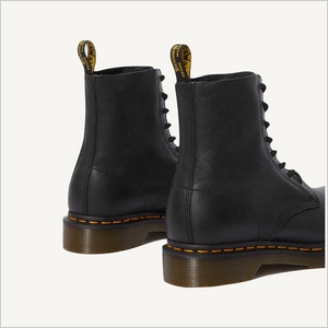 Back angled view of a pair of Dr. Martens 8 Eye 1460 Slip Resistant Lace Boots in Black.