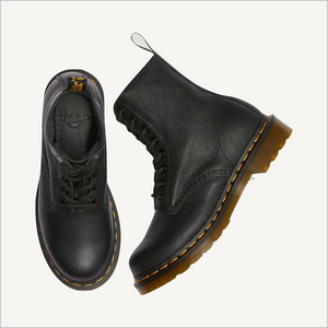 Top view of a pair of Dr. Martens 8 Eye 1460 Slip Resistant Lace Boots in Black. One boot is laying on its side and the other is upright.