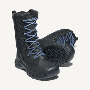 Angled front view of a pair of Keen Greta Tall Waterproof Boots in Black. The boot I the back is tipped on its side with the tread showing.