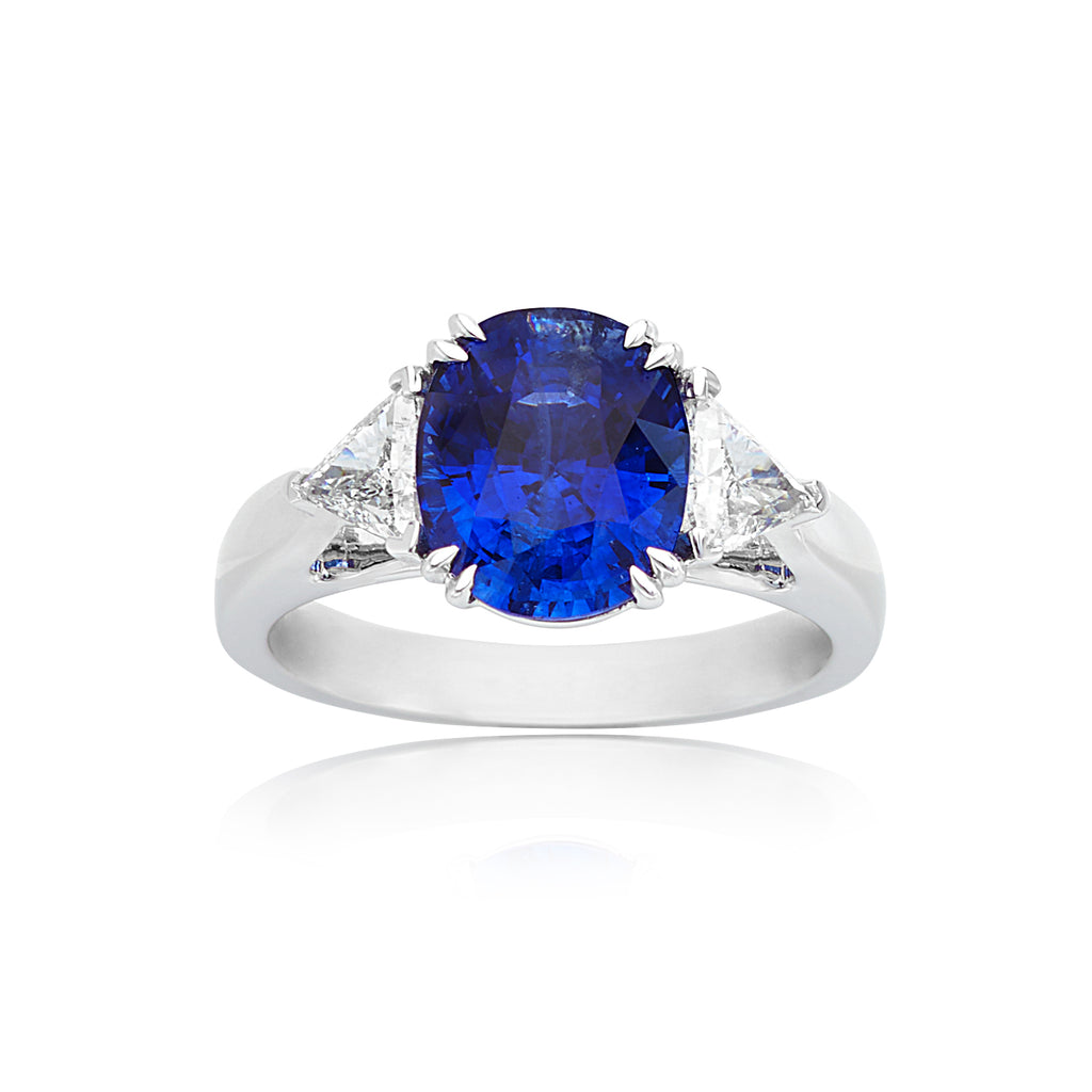 4.04ct Oval Sapphire with 0.54ctw Trillion Diamond Ring in 18kt WG