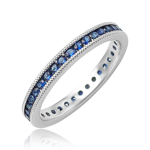 0.62 ctw Round Sapphire Channel Set Eternity Band with Milgrain Detail in 18kt WG