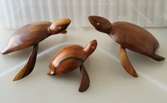 A set of 3 hand carved Turtles - from  Local Miro Wood