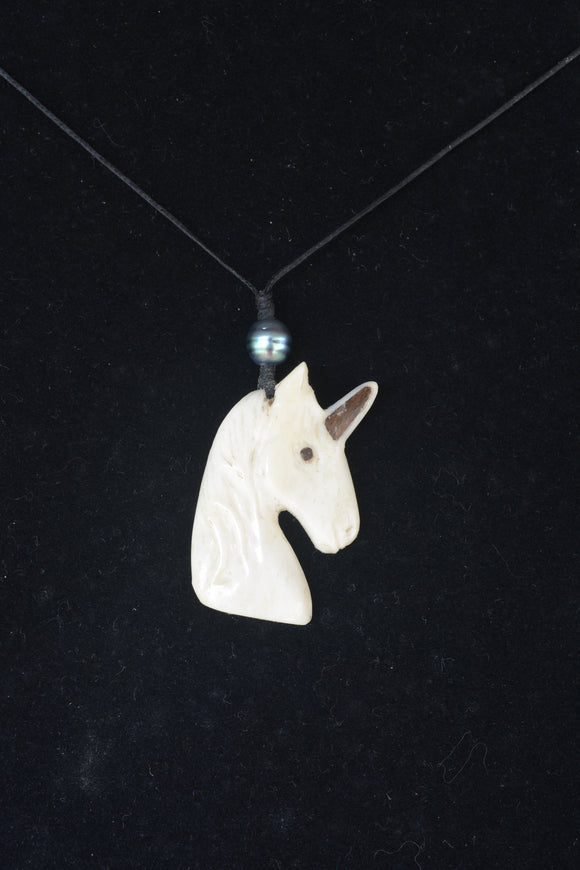 Hand carved bone unicorn necklace
