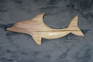 Dolphin carved from local wood