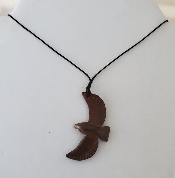Hand carved Soaring Bird Necklace from Local Tau wood