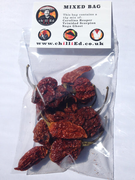Our mixed chilli bag showing the chillies inside and the card that comes with this bag of hot chillies.