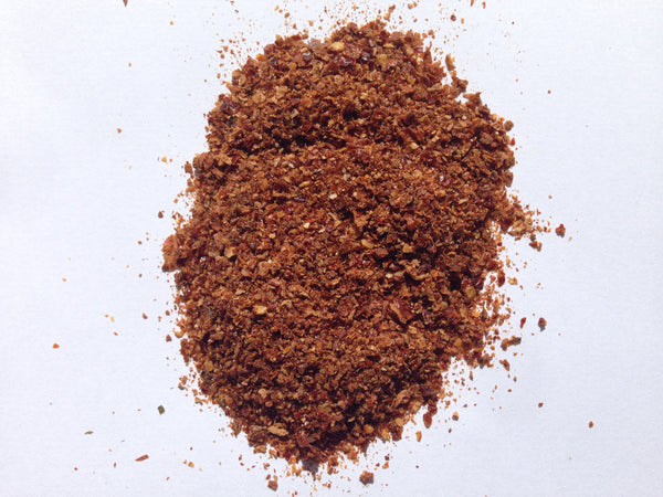 A pile of the beautifully hot three chilli powder. A mix of Carolina Reaper, Trinidad Scorpion and Naga Ghost Chillies