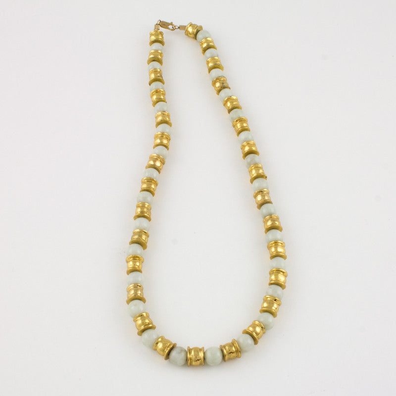 Necklace of white Jade spheres and golden barrels