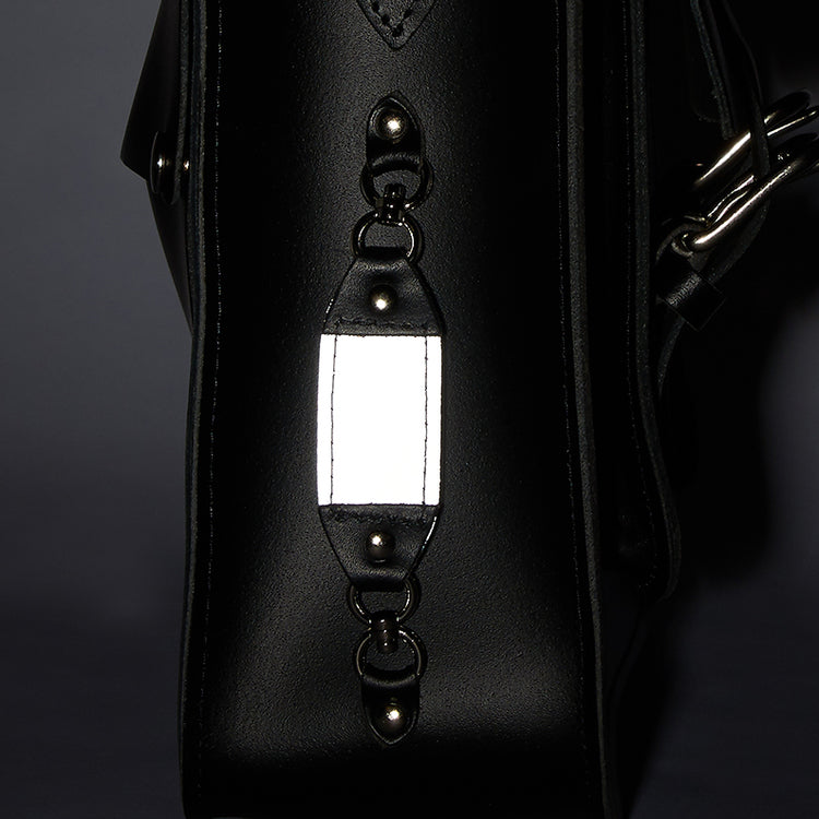 Reflective detailing on a leather bike bag