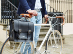 Black satchel cycle bag attached to the bike