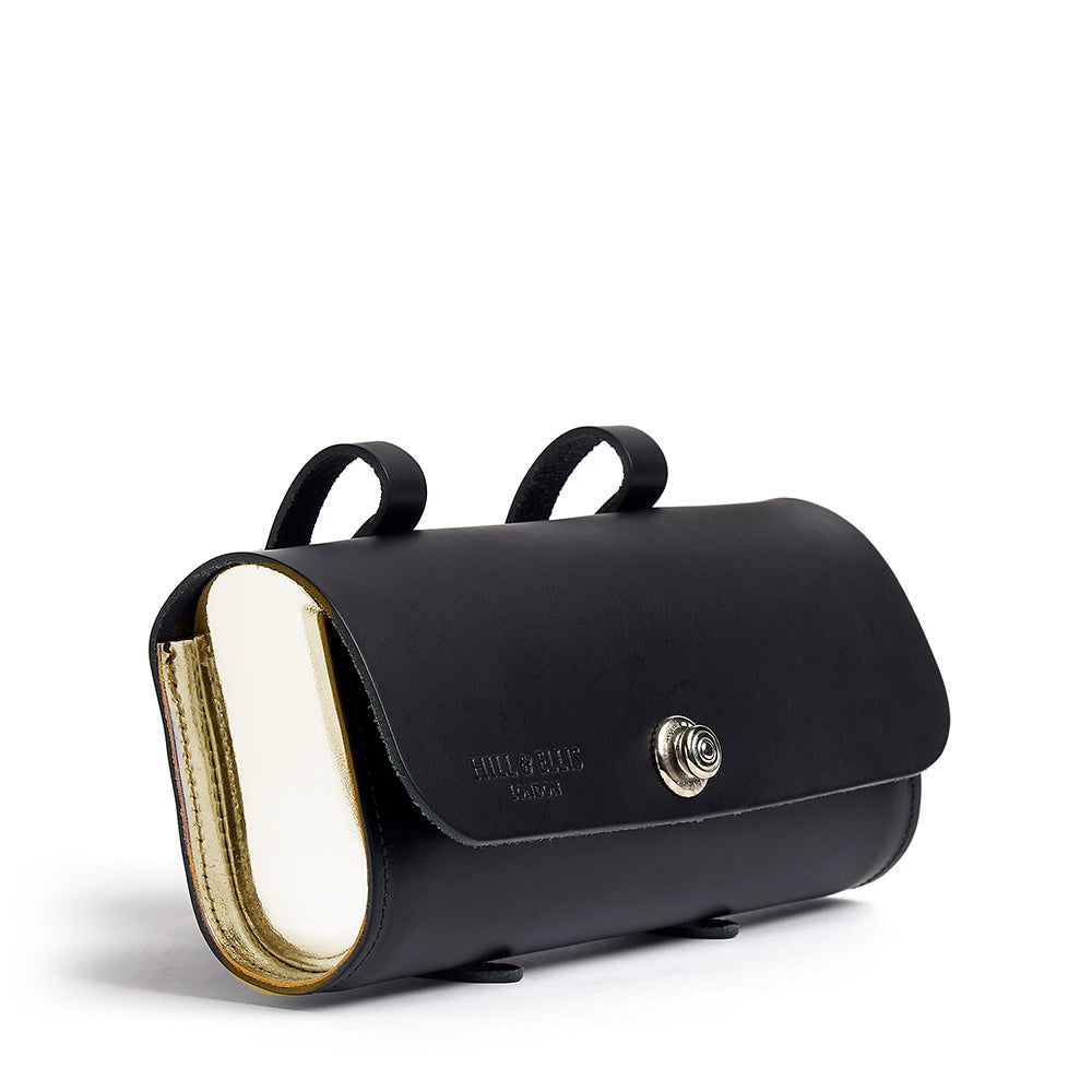 Gold and black saddle bag