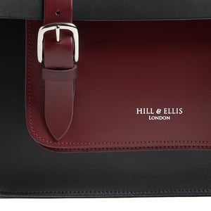 Black and Burgundy leather cycling satchel bag detail