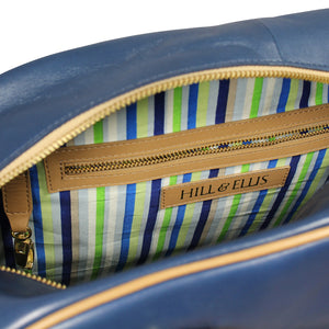 Blue and tan leather cycling bag inside
