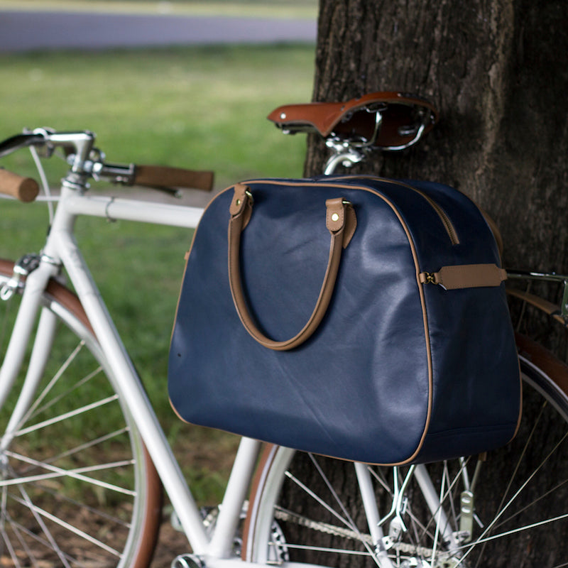 Blue and tan leather cycling bag on bicycle