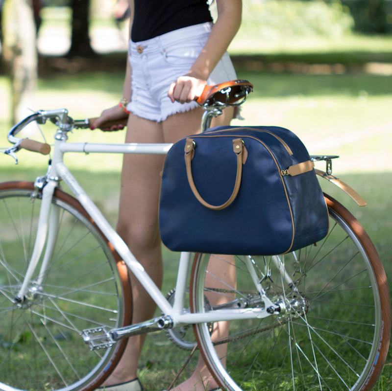 Blue and tan leather cycling bag on bicycle rack