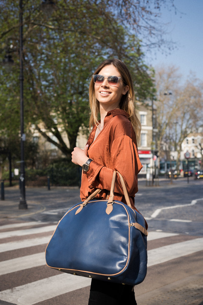 Blue and tan leather bowling bag for cycling