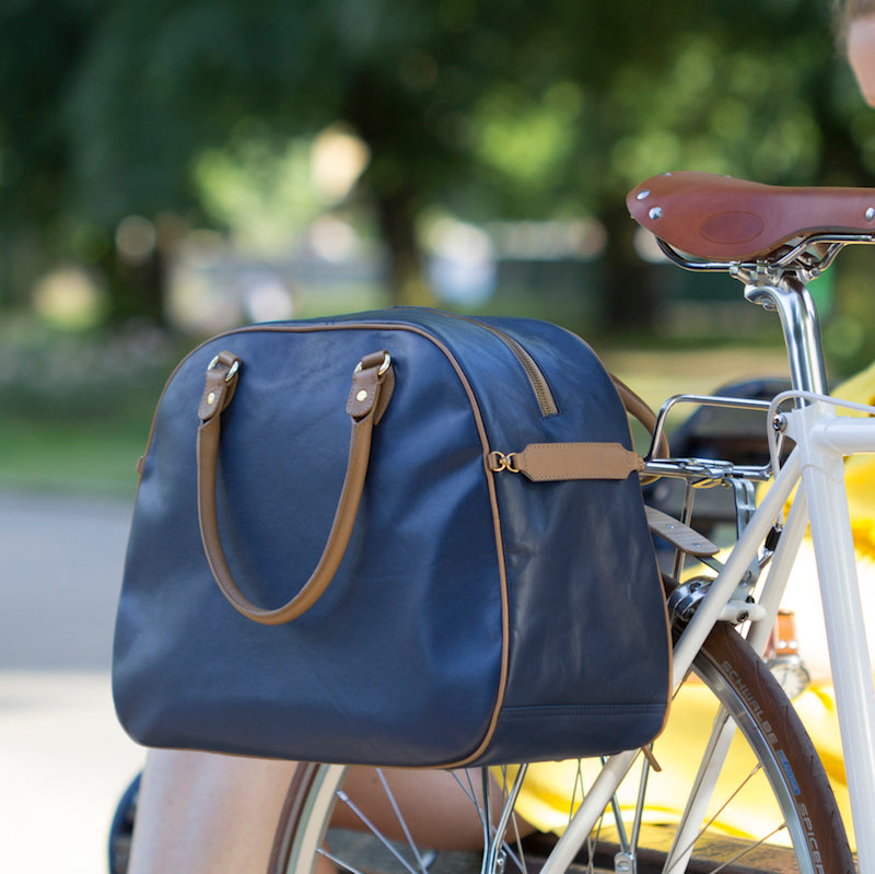 Blue and tan leather cycling pannier bag on bicycle