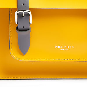 Yellow leather satchel cycle bag detail of Hill & Ellis embossing