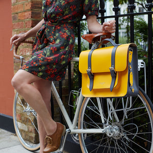 Yellow leather satchel cycle bag on bicycle