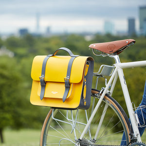 Yellow leather satchel cycle bag attached to bicycle