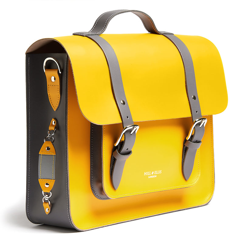 Bright yellow leather satchel cycle bag with reflective detailing